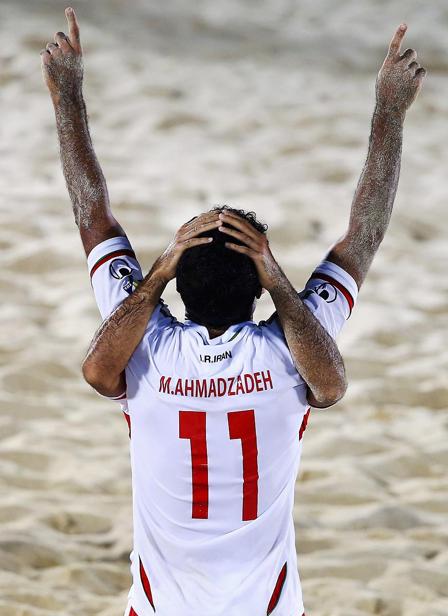 Mohammed Ahmadzadeh celebrates with Amir Akbari Farthouni after scoring a goal at the Samsung Beach Soccer Intercontinental Cup Dubai 2014.