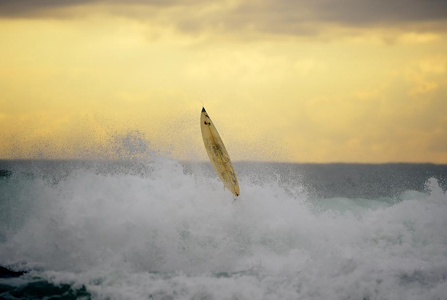 A surfer crashes in a wave in Varazze, western Genova, as bad weather creates a swell in the Mediterranean Sea.