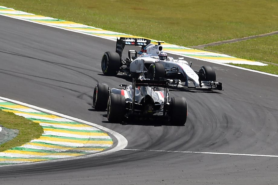 Valtteri Bottas (front) and Adrian Sutil go in different directions while practicing for the Formula One World Championship.