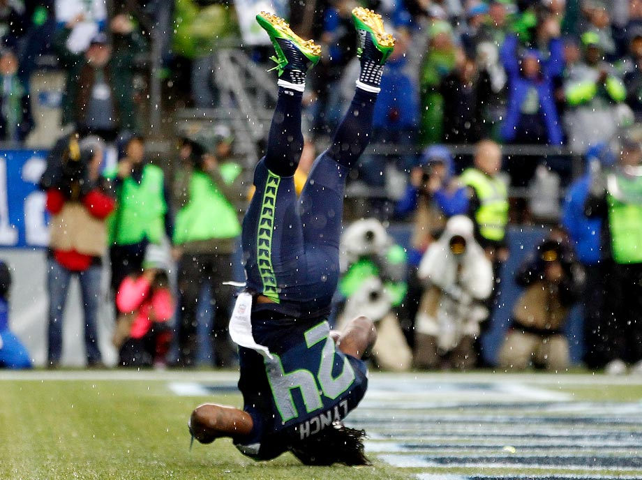 Marshawn Lynch of the Seahawks dive into the end zone for a touchdown against the New York Giants.