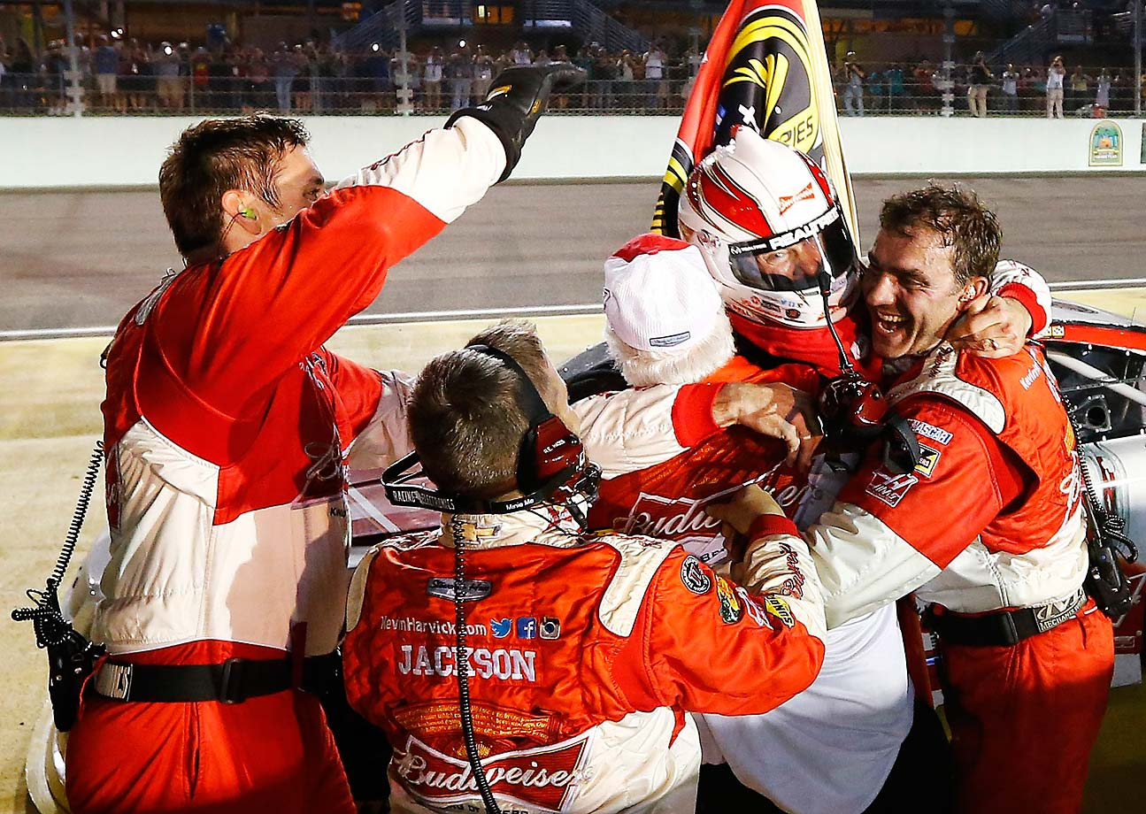 Kevin Harvick celebrates with his team after winning the title.