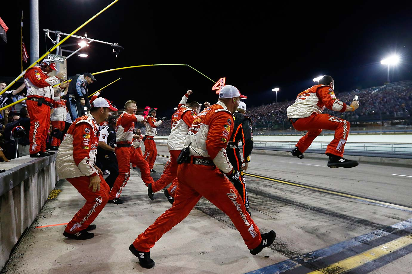 The team of Kevin Harvick goes wild after his win at the season finale gave him his first Sprint Cup title.