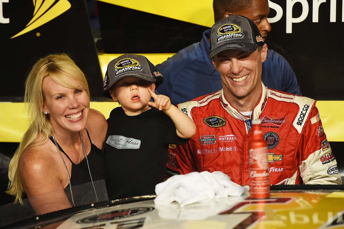 Kevin Harvick, wife DeLana and son Keelan in victory lane after Kevin won the 2014 NASCAR championship.