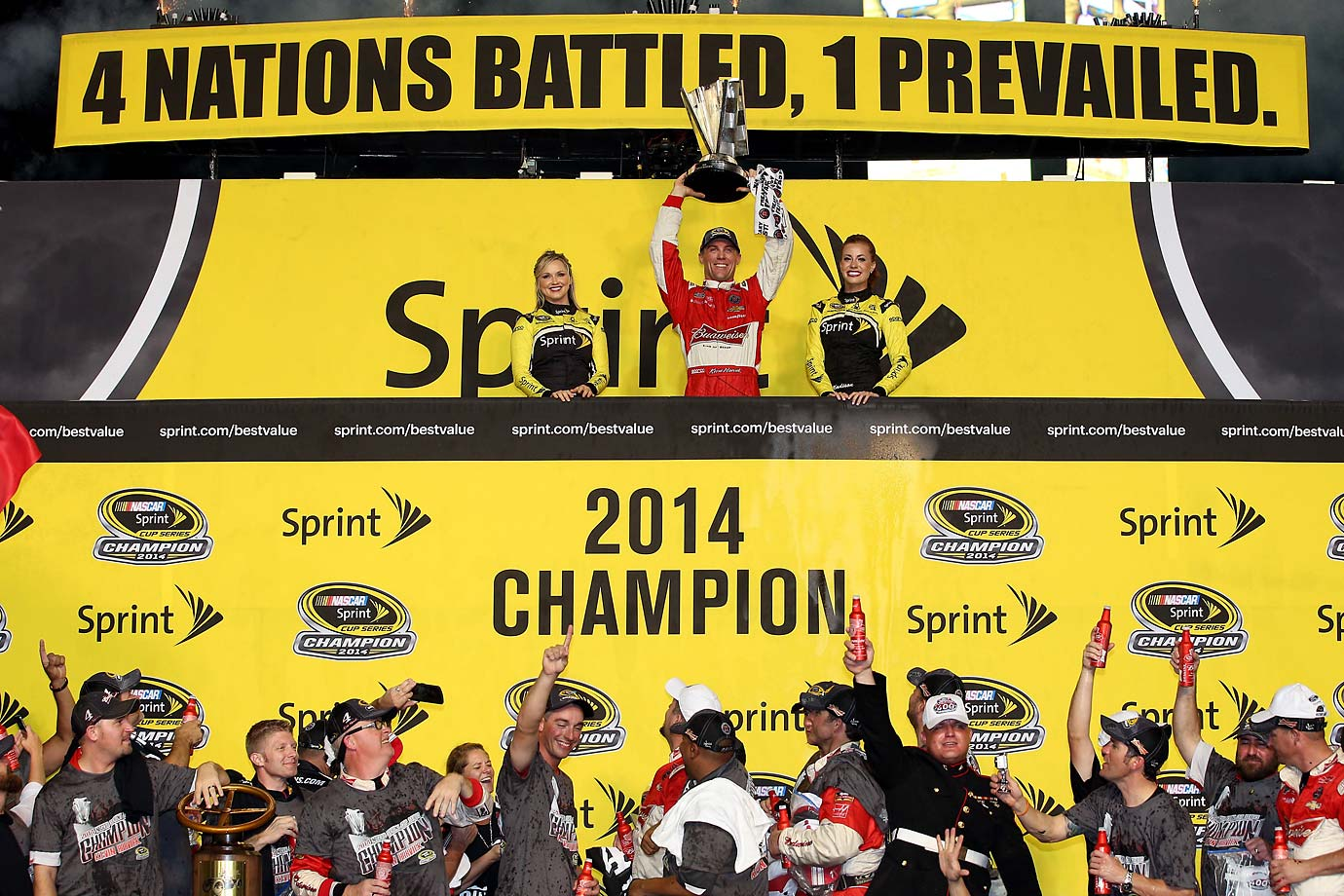 Kevin Harvick hoists the trophy in victory lane.