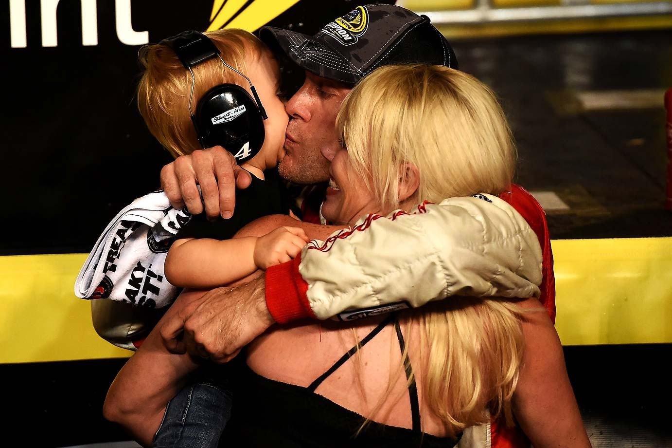 Kevin Harvick celebrates with wife DeLana and son Keelan in victory lane.