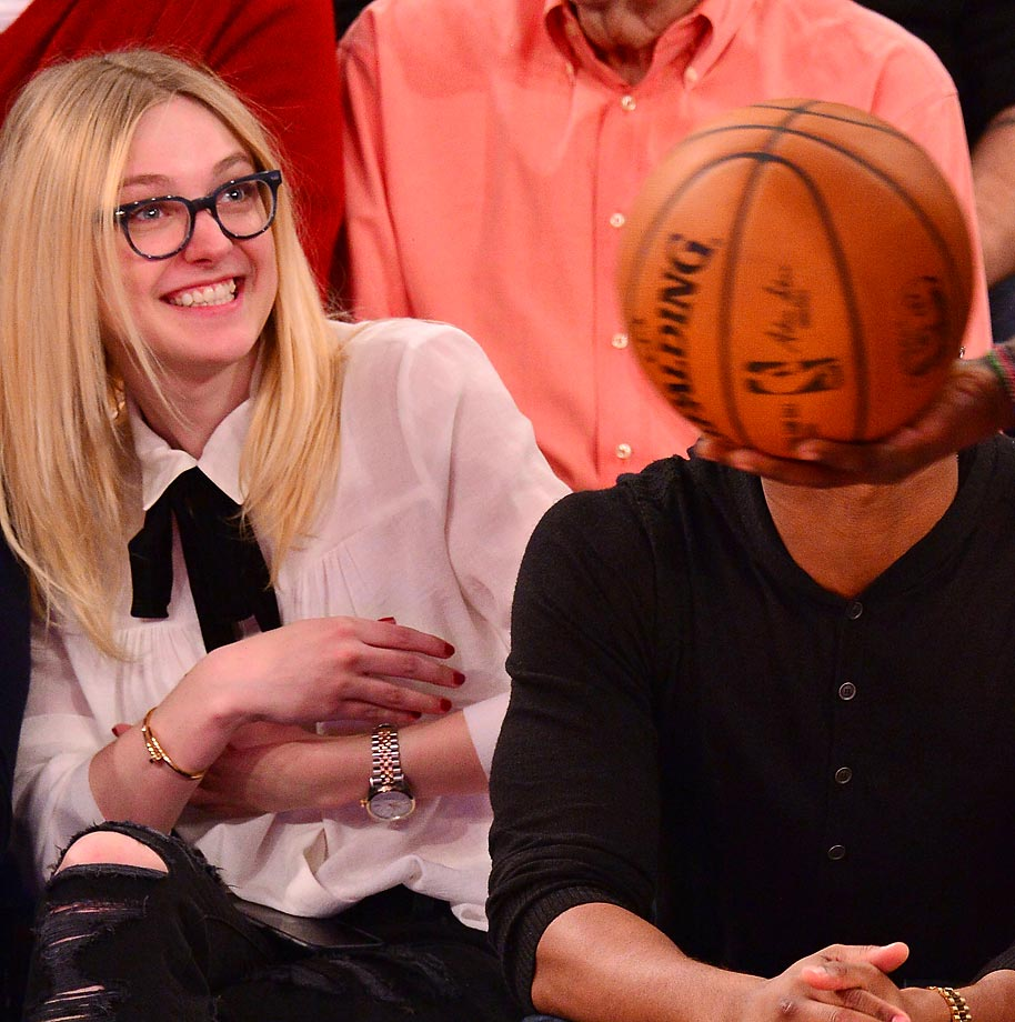 Dakota Fanning and a friend at a Miami Heat-New York Knicks game at Madison Square Garden.