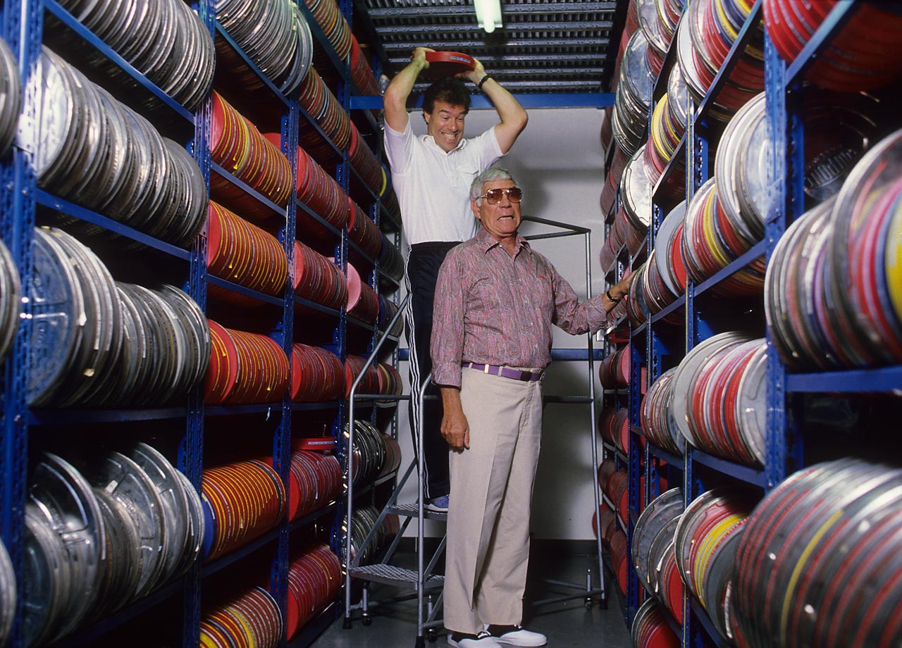 NFL Films founders Ed and Steve Sabol pose at the NFL Films headquarters in New Jersey as Steve jokingly takes out the day's frustrations on his father.