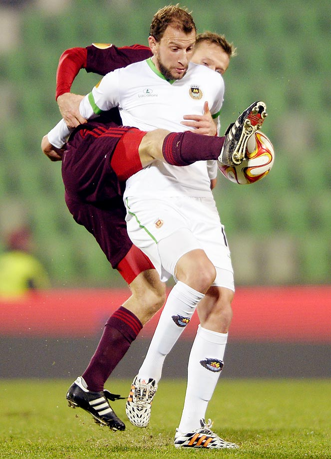 Rasmus Wurtz (left) vies with Renan Bressan during a UEFA Europa League Group J football match.