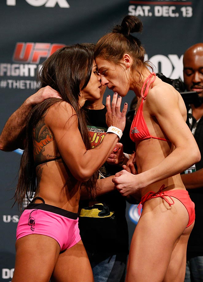 Claudia Gadelha and Joanna Jedrzejczyk face off during the UFC Fight Night weigh-in event at the Phoenix Convention Center.