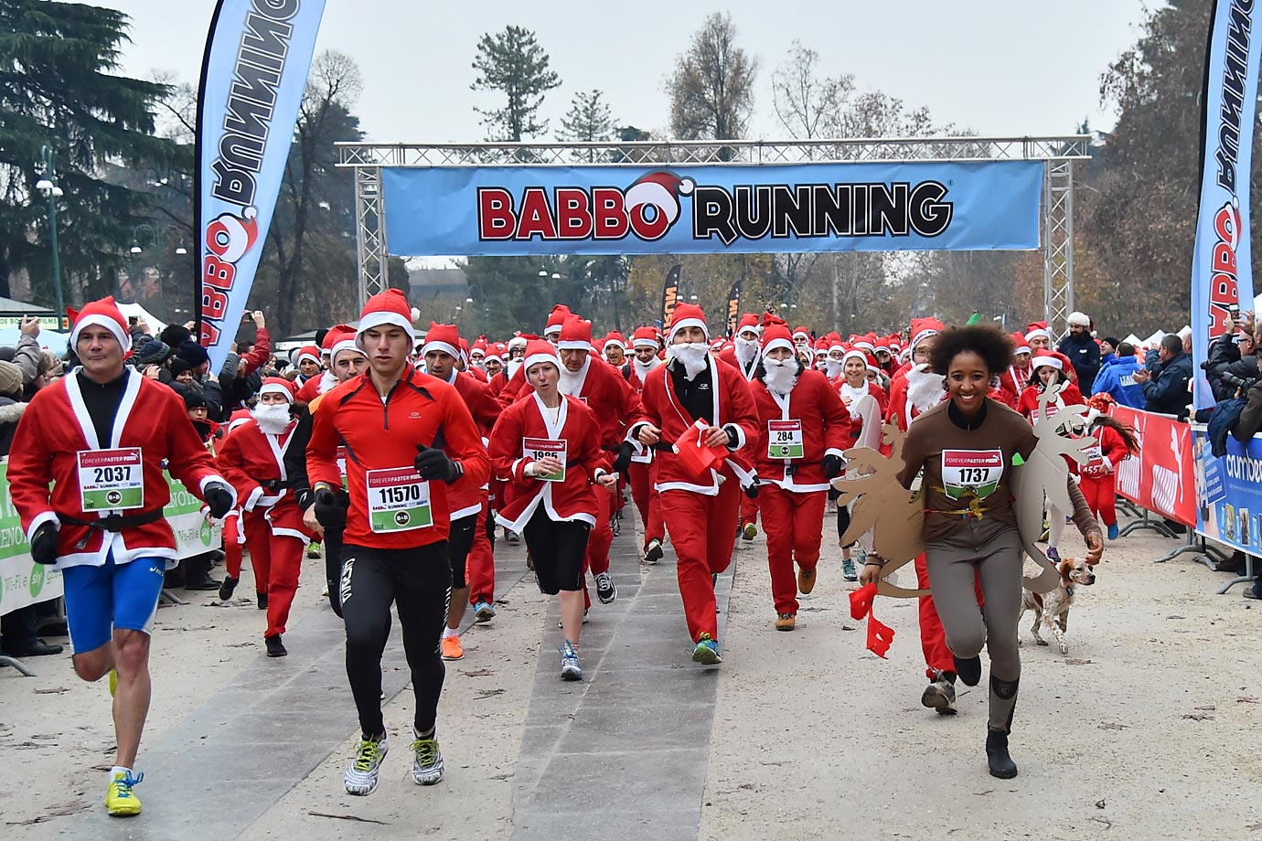 Contestants wear costumes as they take part in a Santa Claus-themed race in downtown Milan.