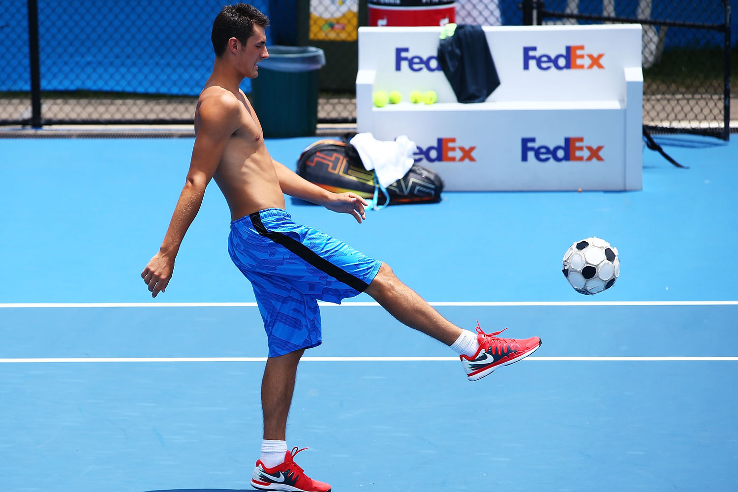 Bernard Tomic warms up before a training session on back courts during the Sydney International at Sydney Olympic Park Tennis Centre in early January 2014.