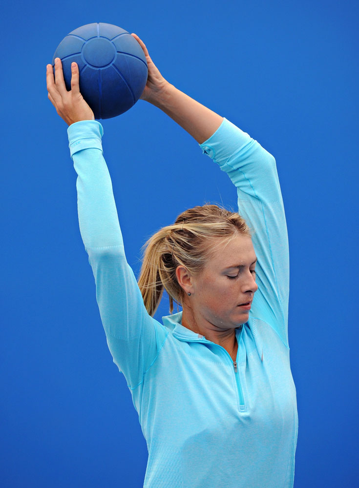 Maria Sharapova warms up before a practice session ahead of the 2014 Australian Open at Melbourne Park on January 12, 2014.