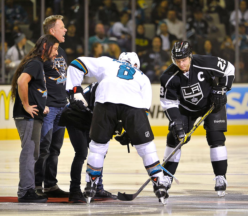 Larry Trujillo and James Hetfield of Metallica drop the puck on Metallica Night at a San Jose Sharks game.