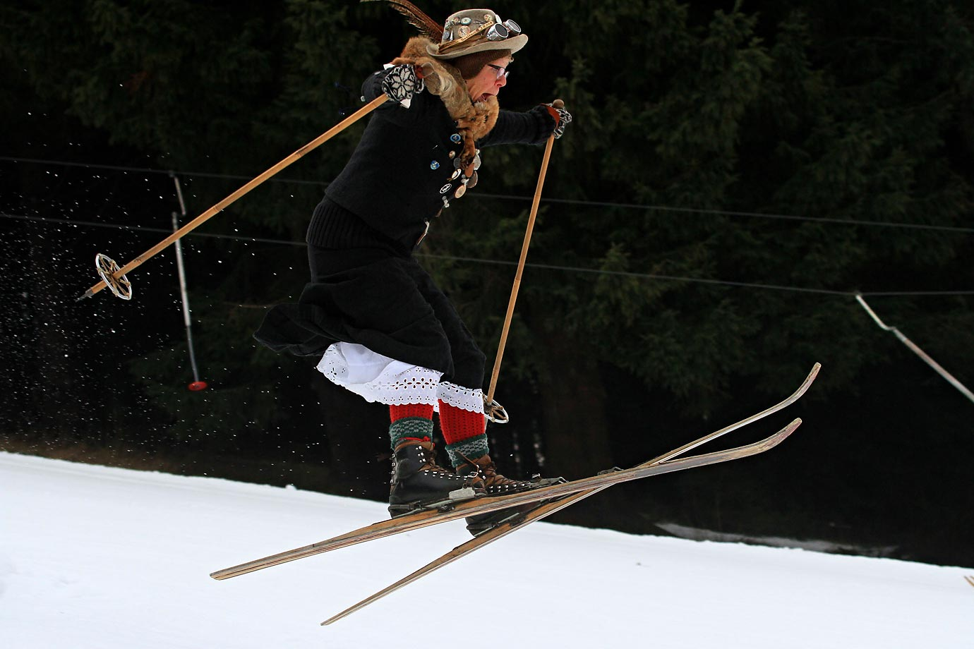A skier from Austria takes part in the skiing championships on old wooden skis from the 19th century in Olesnice, east Bohemia.