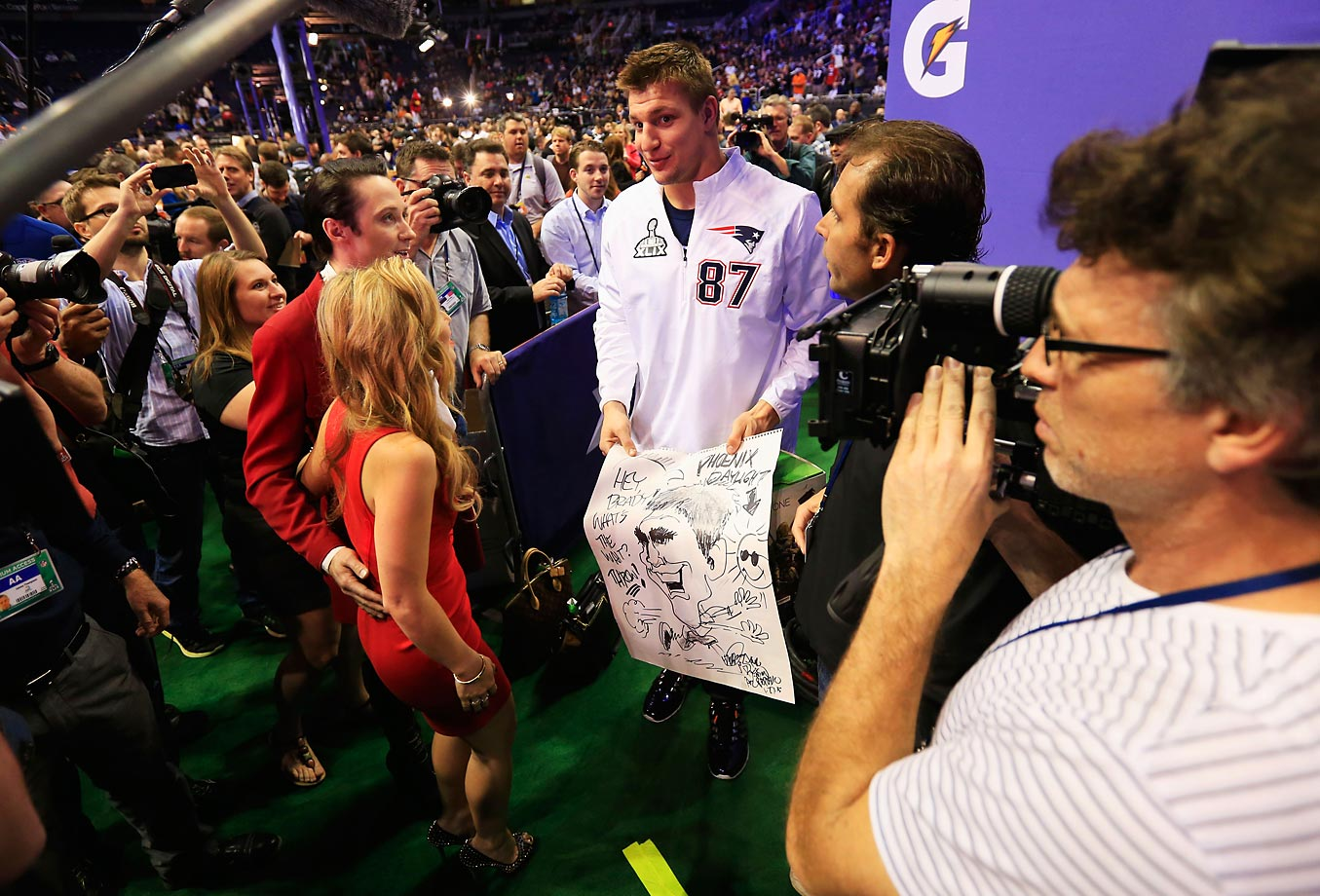 Rob Gronkowski with Johnny Weir and Tara Lipinski at Super Bowl XLIX Media Day.