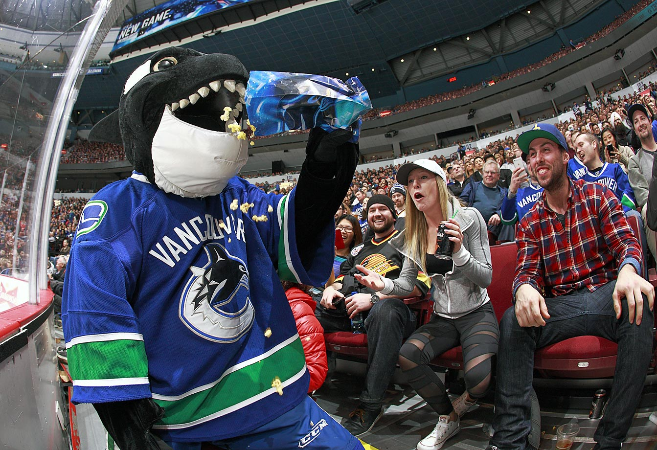 Vancouver Canucks' mascot Fin feasts on some popcorn during a game against the Winnipeg Jets.