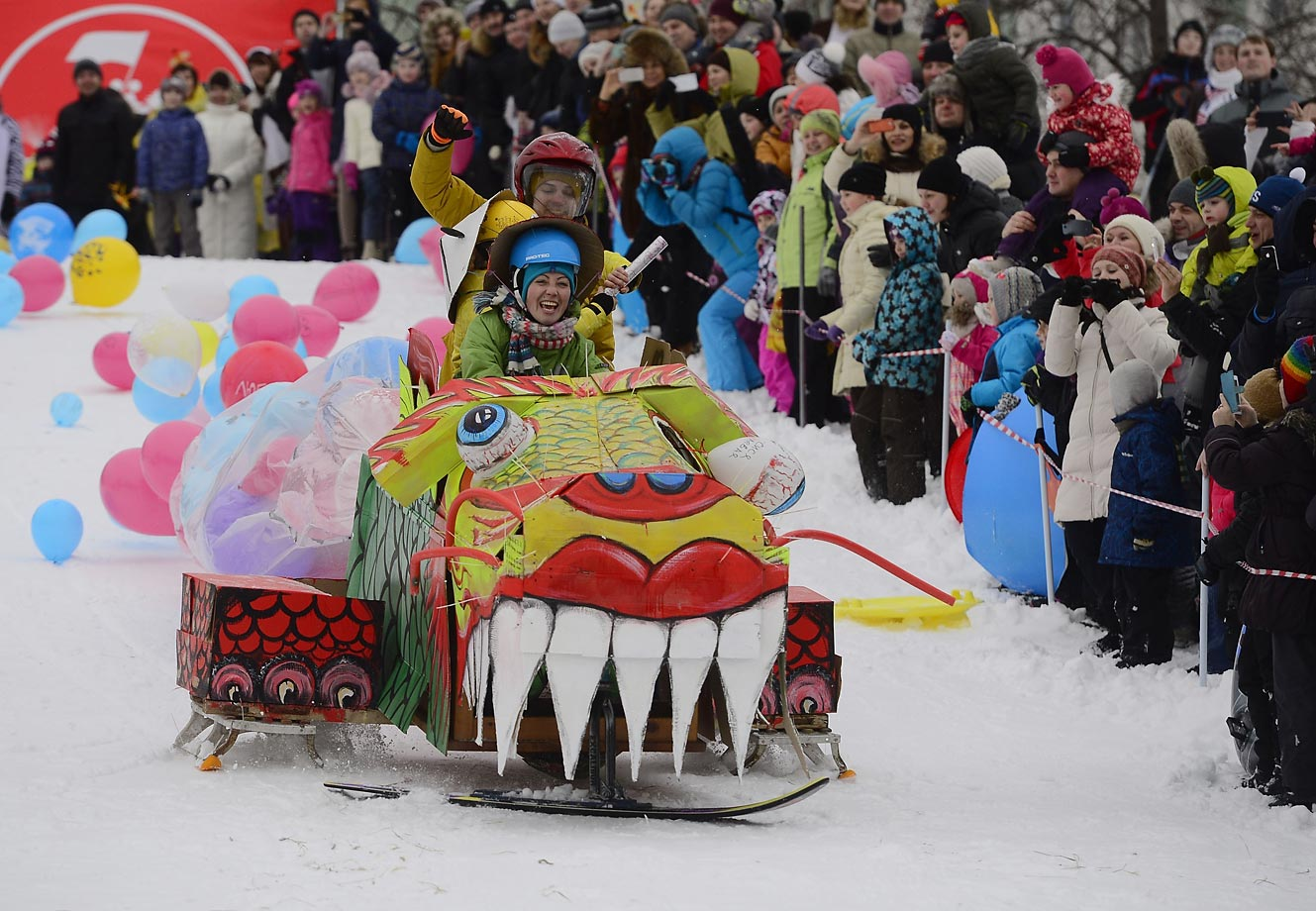 People sledging during Winter SaniDay 2015 in Moscow.