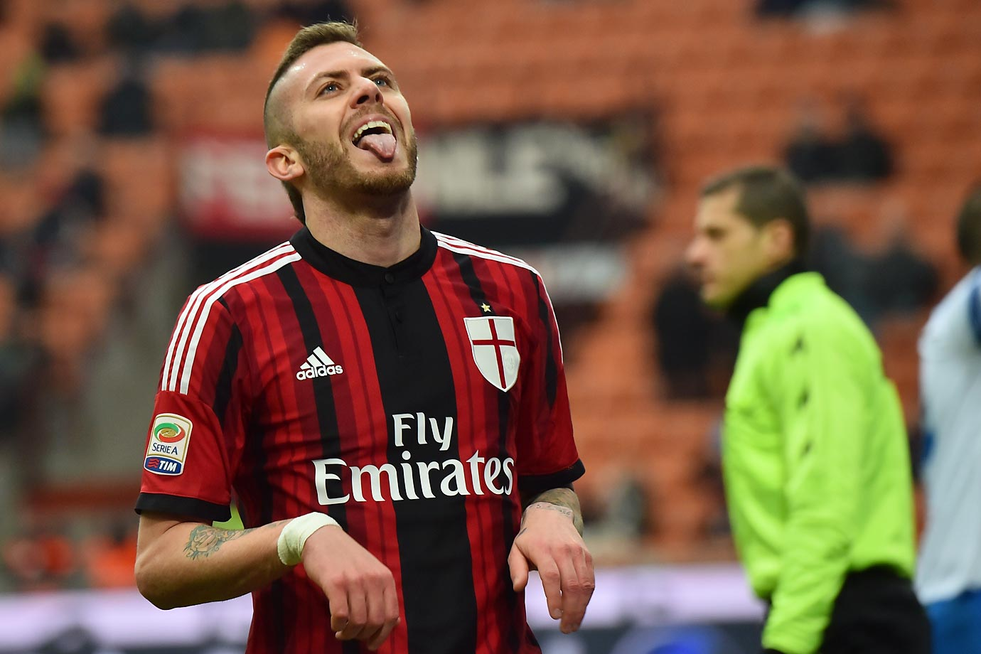 AC Milan's midfielder Jeremy Menez poses as a dog during the Italian Serie A football match between AC Milan and Empoli.