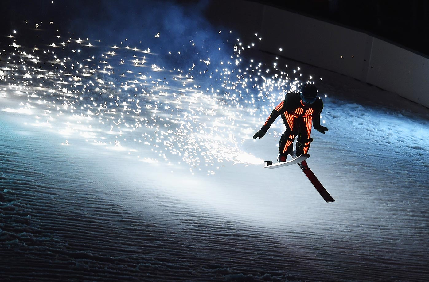 A ski jumper lands during the Opening Ceremony of the FIS Nordic World Ski Championships in Falun, Sweden.