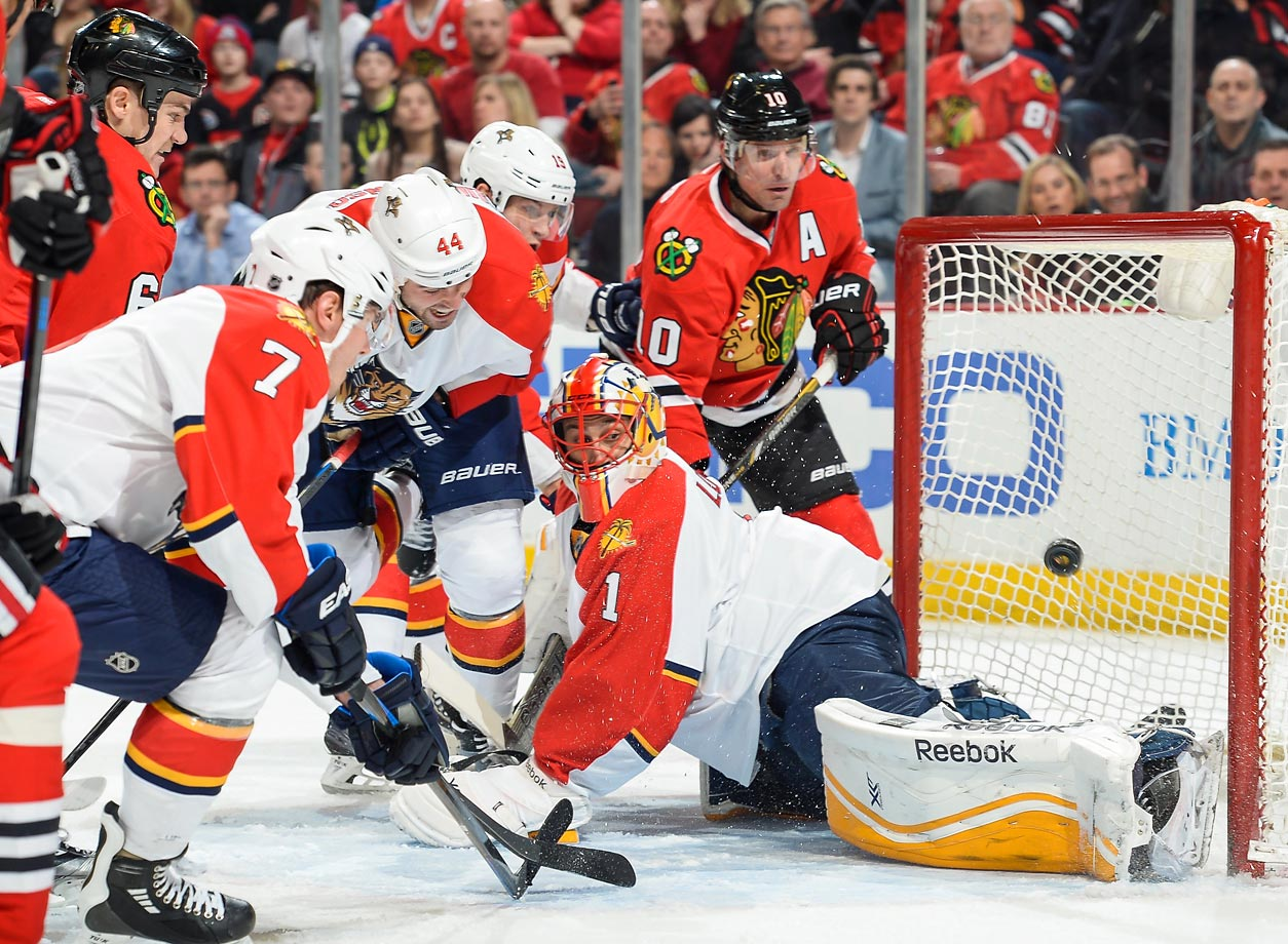 Erik Gudbranson (44) and Patrick Sharp (10) watch the puck get past goalie Roberto Luongo (1) during a game between the Florida Panthers and Chicago Blackhawks.