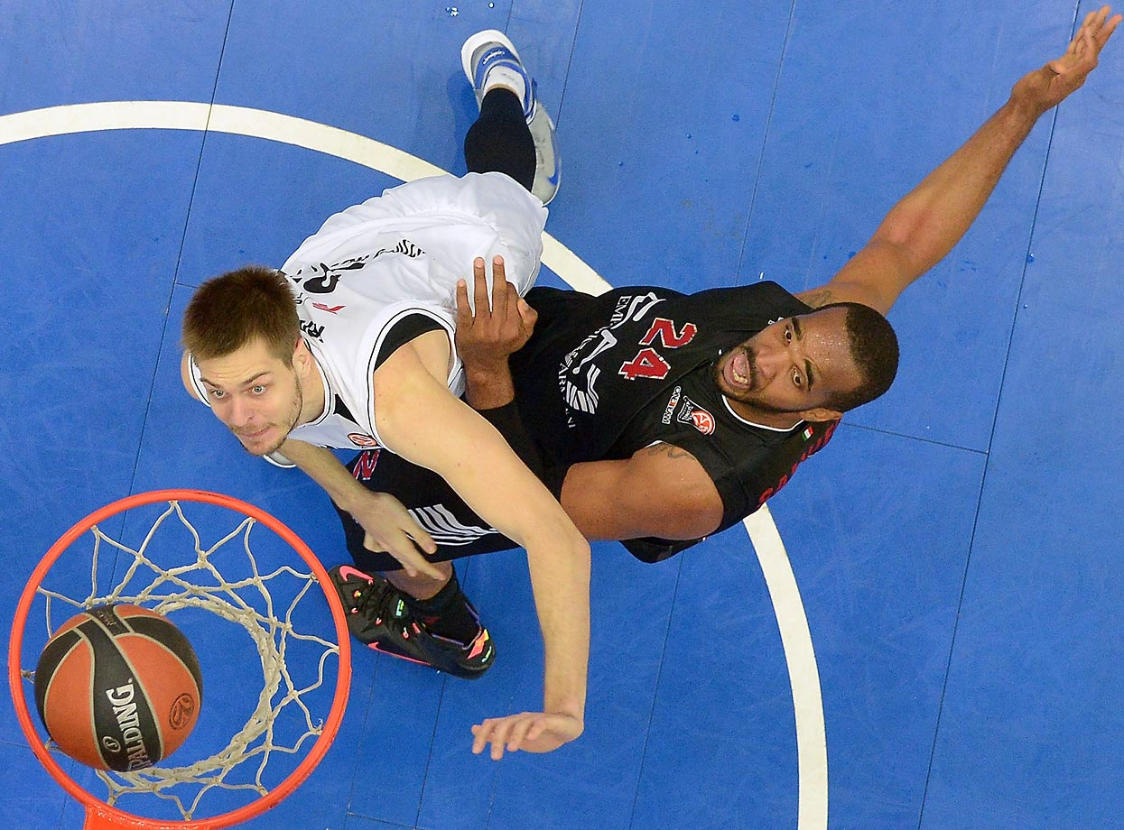 Maksim Krivosheev (31) competes with Samardo Samuels (24) during a Turkish Airlines Euroleague Basketball game.