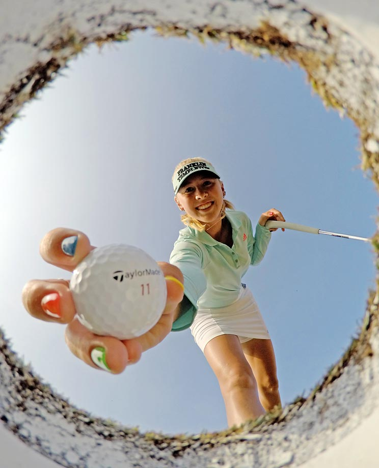 Not sure how the cameraman got this angle of Jessica Korda taking a ball out of the hole during the HSBC Women's Champions in Singapore.