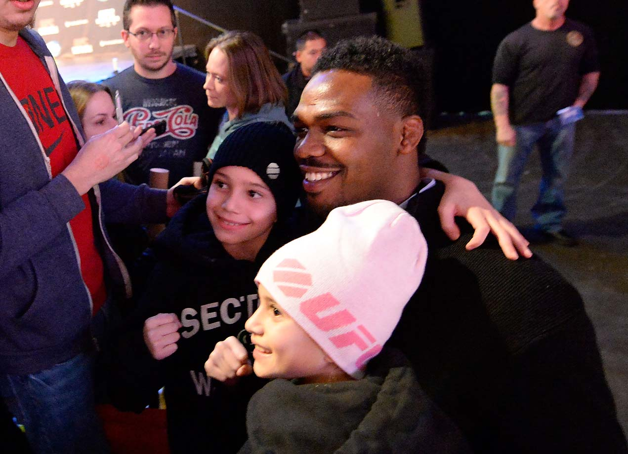 Jon Jones poses with little fans ahead of his UFC 169 bout with Chael Sonnen in Newark, N.J.
