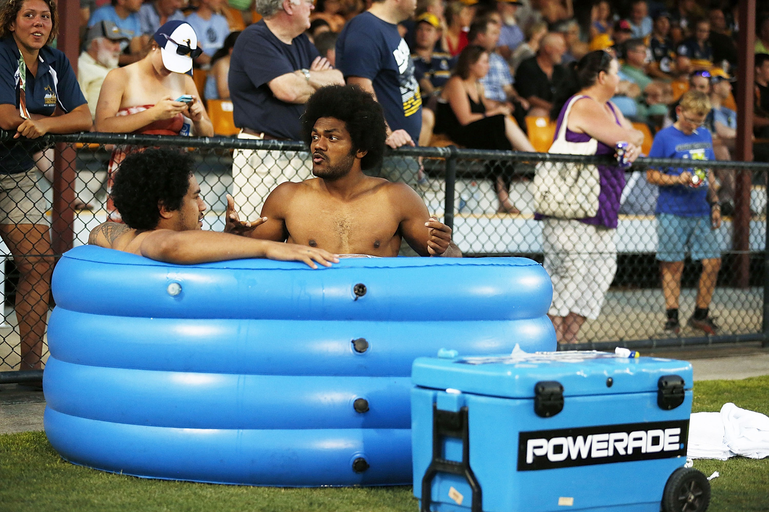 Henry Speight (C) cools off in an ice bath during the Super Rugby trial match between the Brumbies and the ACT XV at Viking Park in Canberra, Australia.