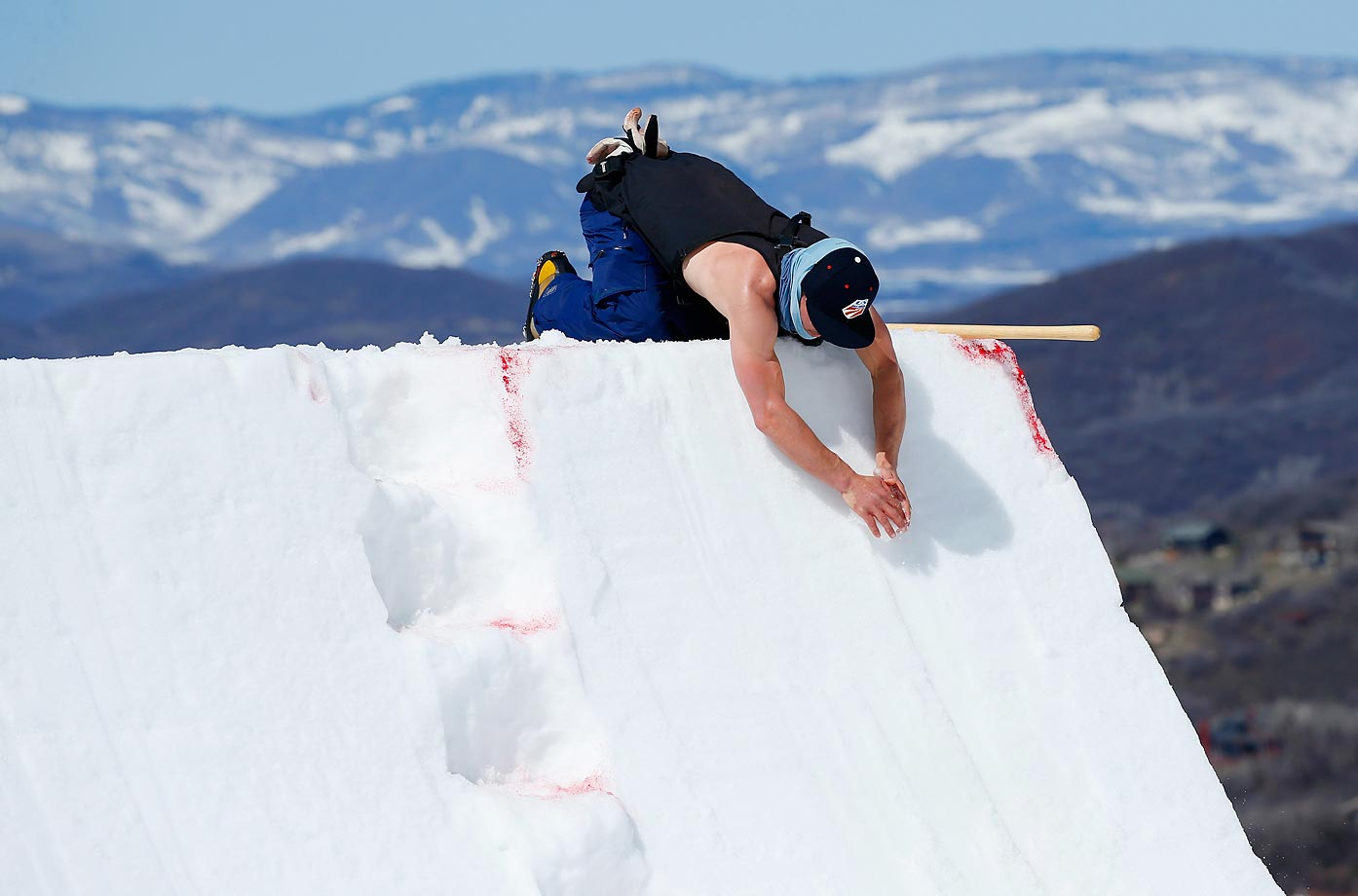 A course worker makes finishing touches as warm weather greets the aerials competition at the 2015 U.S. Freestyle Ski National Championships at Steamboat Ski Resort.