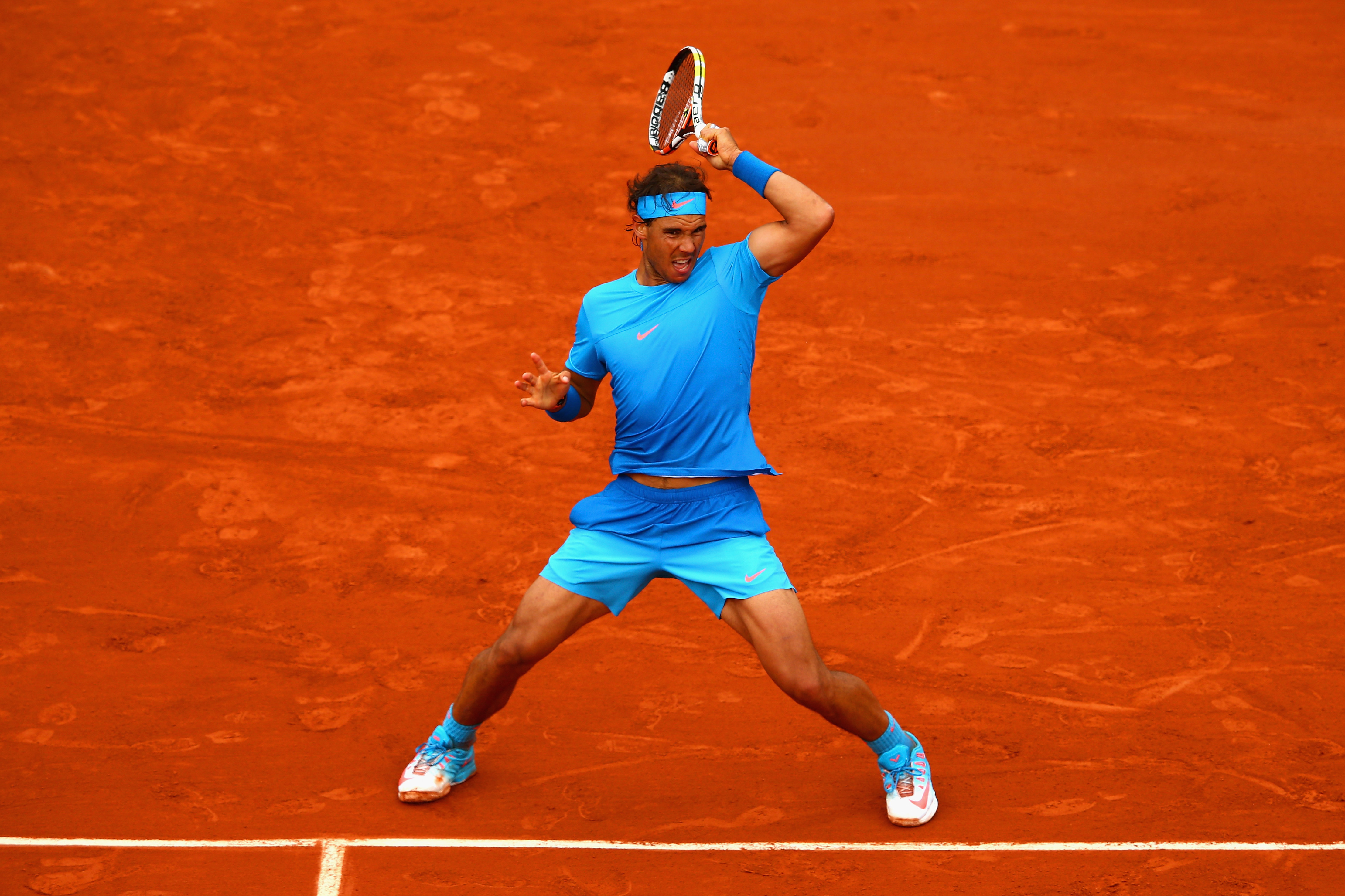 The blue looks great against the red clay but did he really need *that* much blue?