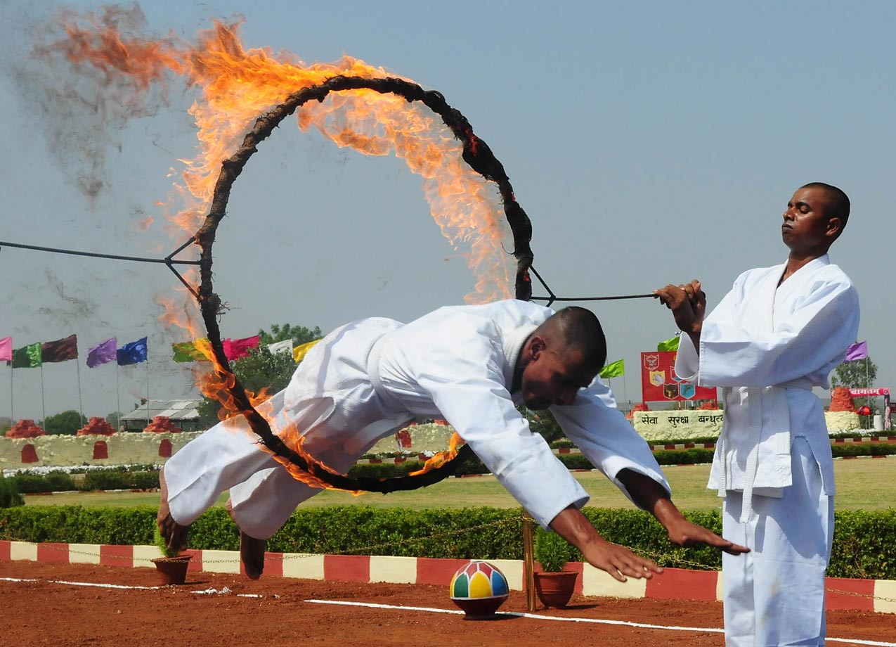 Sashastra Seema Bal jawan passes through a fire ring during training in Bhopal, India.