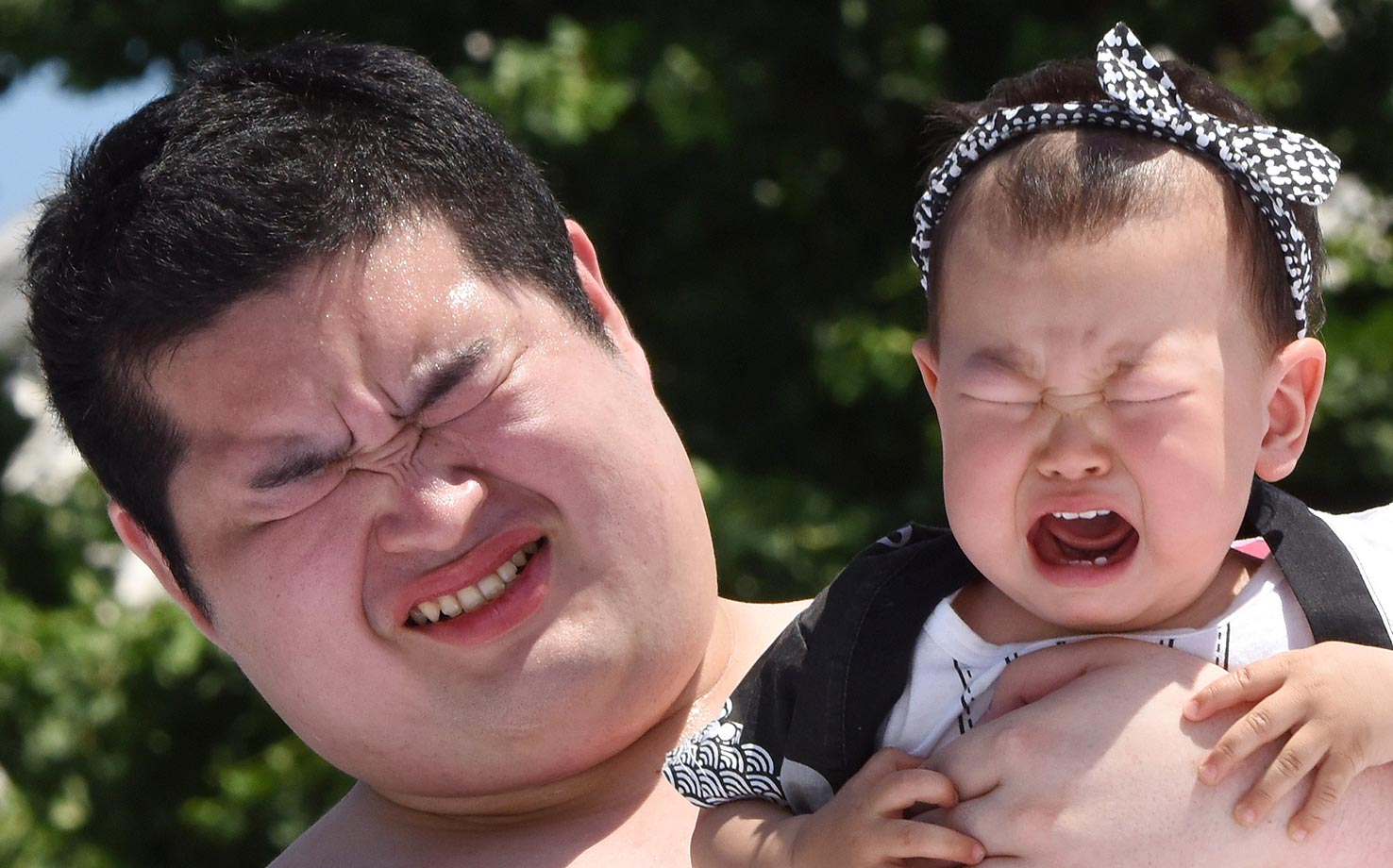 "The ""Baby-cry Sumo"" competition at the Sensoji temple in Tokyo. Japanese parents believe that sumo wrestlers can help make babies cry out a wish to grow up with good health."