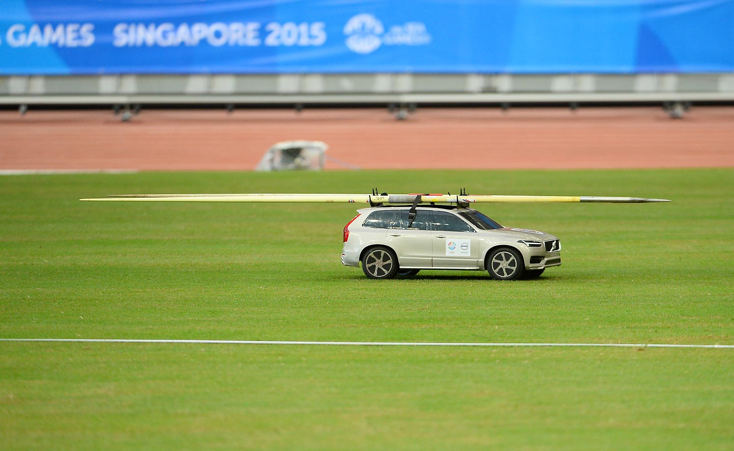 A remote-controlled car transports a pair of javelins on June 10 at the Southeast Asian Games in Singapore.