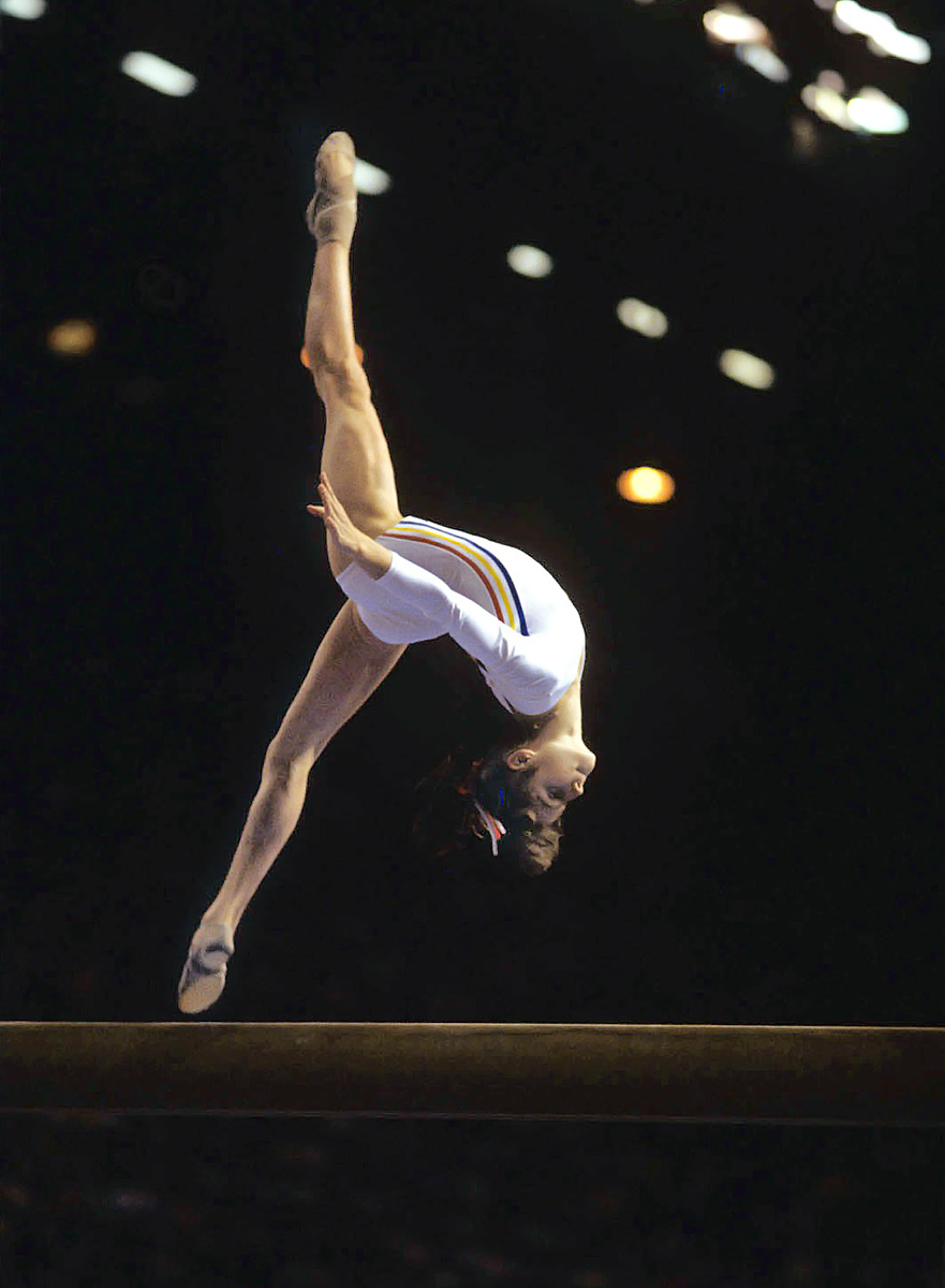 Montreal Summer Olympics, Aug. 2, 1976 | Nadia Comaneci of Romania completes a somersault during the 1976 Summer Olympics in Montreal. Comaneci was the first gymnast to ever be awarded a perfect score in an Olympic gymnastic event, and in total, won three gold medals in Montreal.