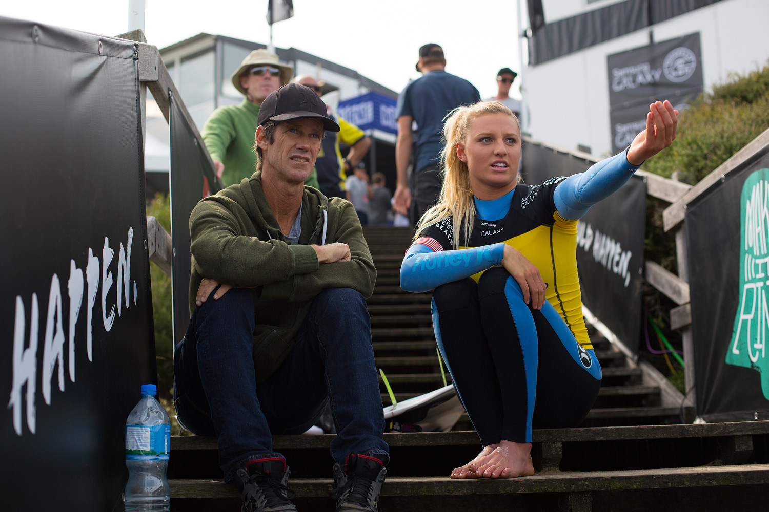 Lakey Peterson talks with her coach Mike Parsons at the Rip Curl Pro Bells Beach.