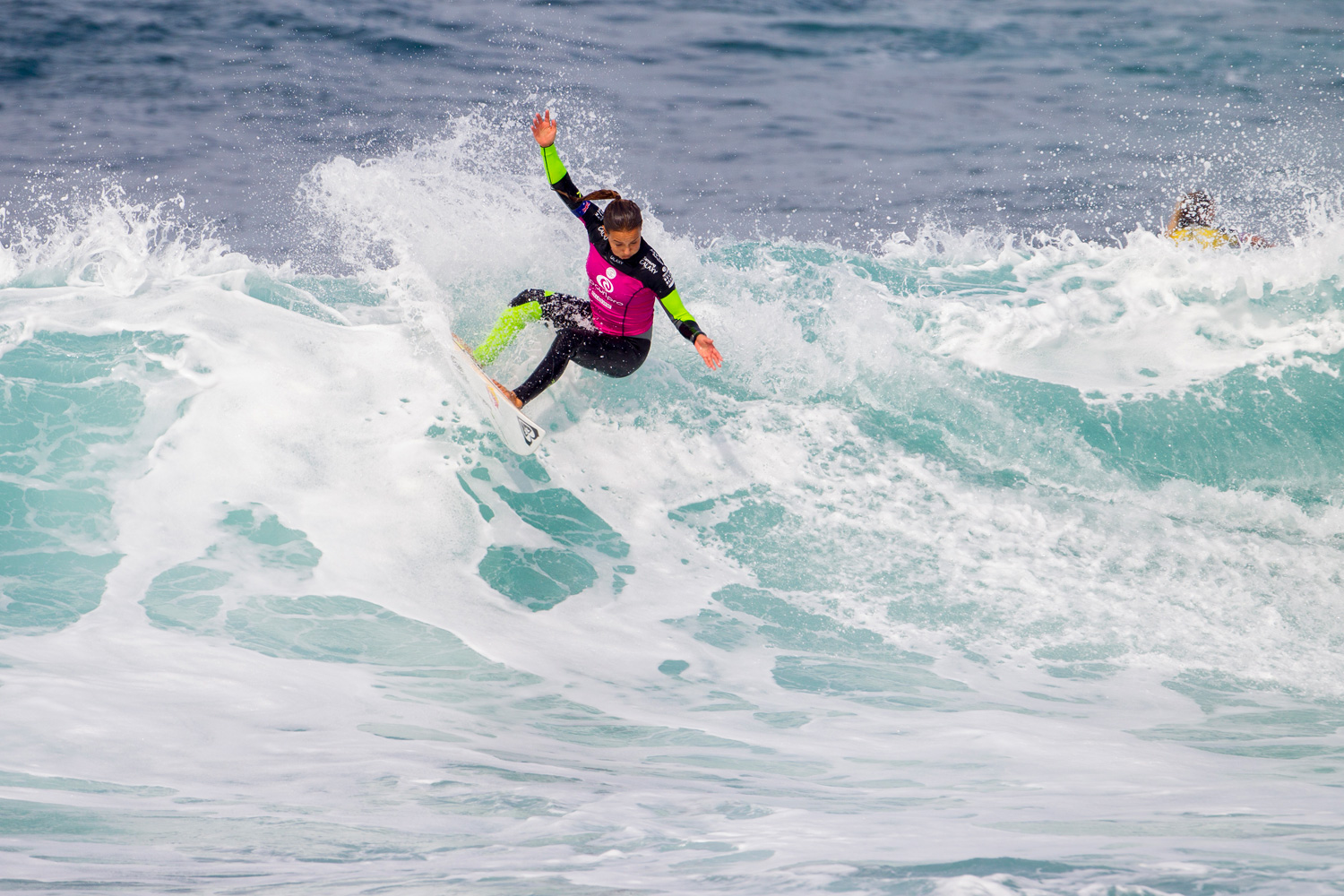 Sally Fitzgibbons surfs to victory in the second heat of Round 1 of the Rip Curl Pro Bells Beach with a mark of 12.94.