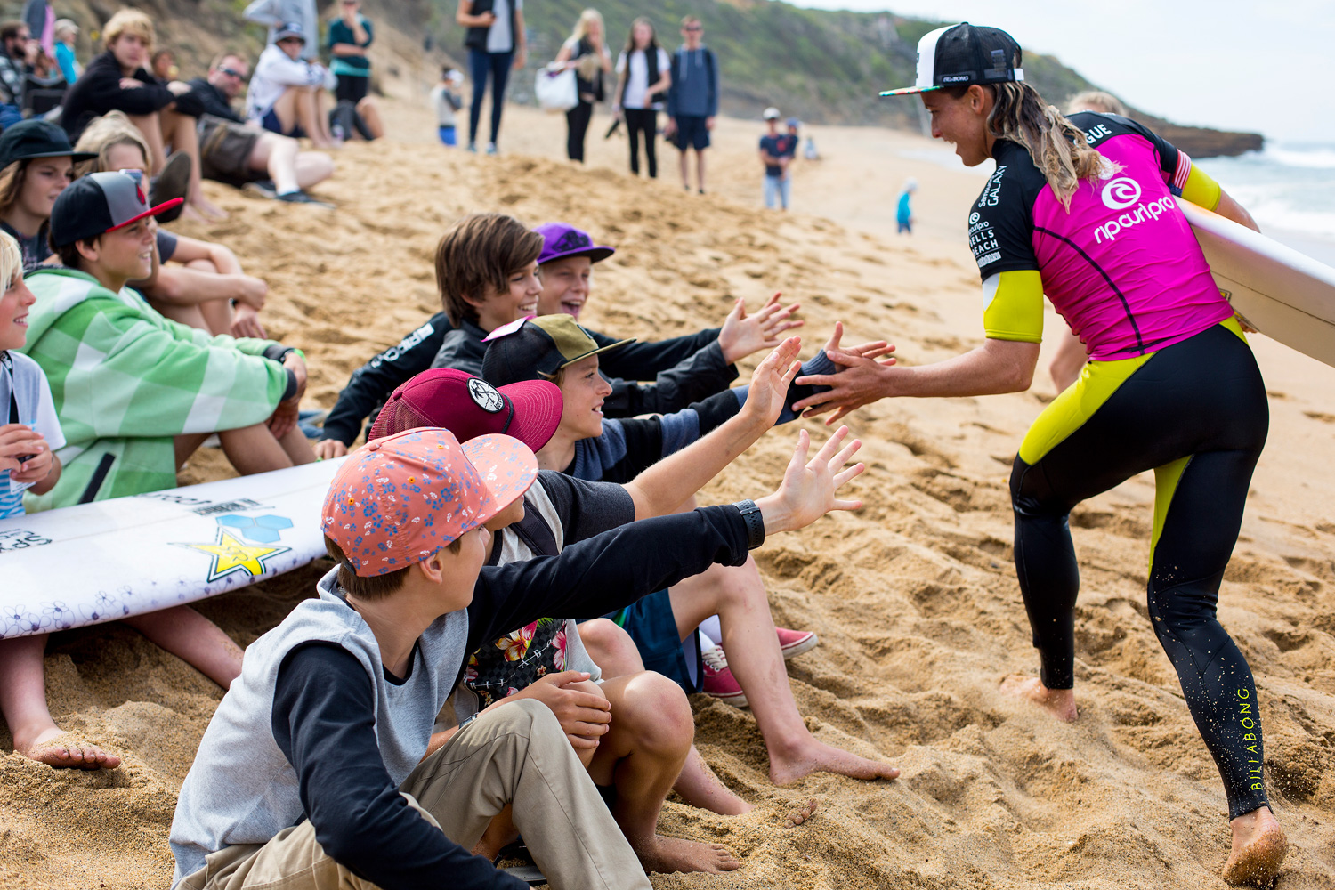 Courtney Conlogue of Australia high fives her fans on April 16, 2014 in Bells Beach, Australia.