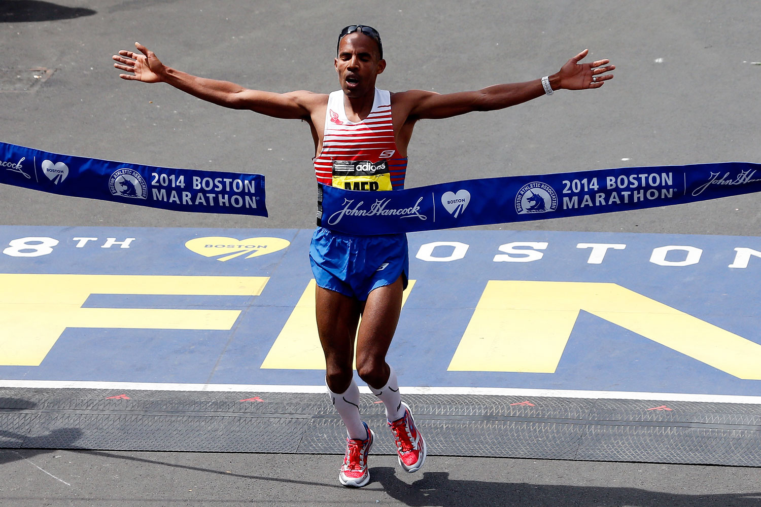 Meb Keflezighi crosses the finish line to become the first American to win the Boston Marathon since 1983 on April 21, 2014.