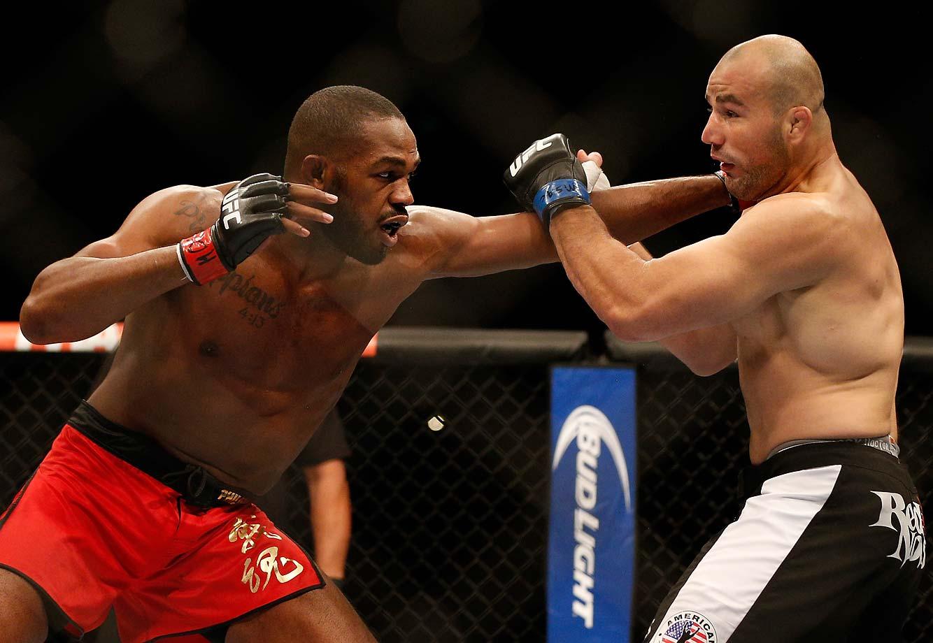Jones tags Glover Teixeira with a straight left.
