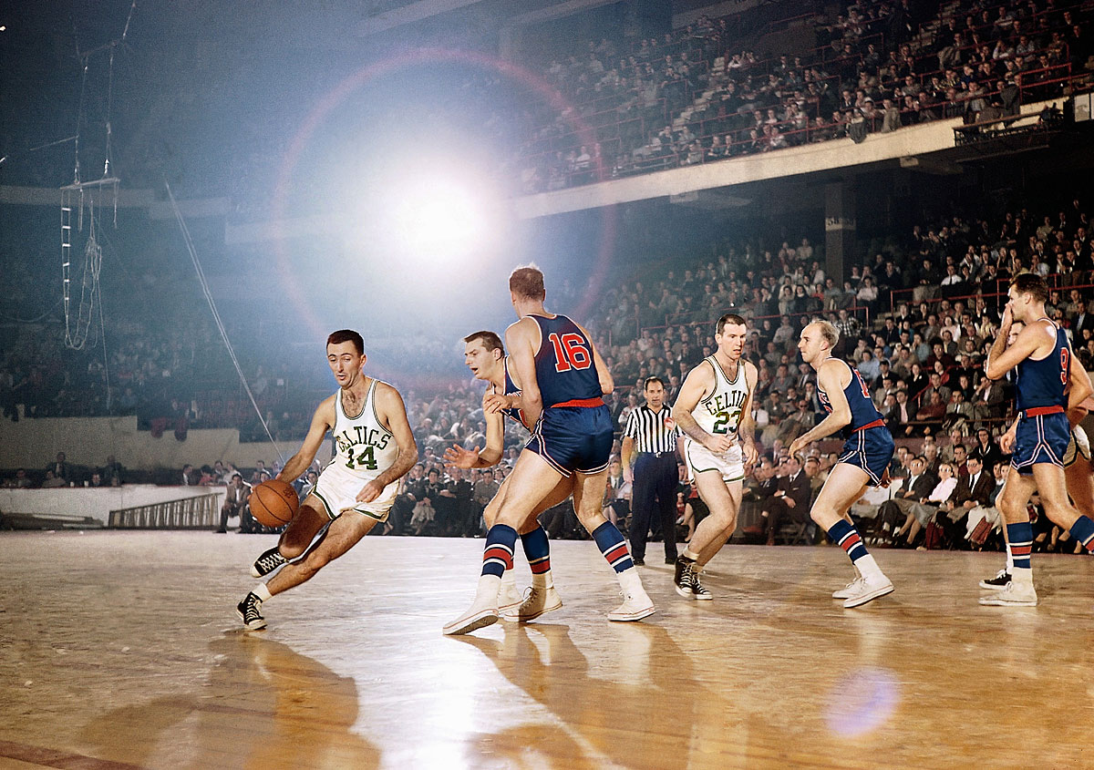 Pistons at Celtics, Nov. 19, 1955 | Boston Celtics point guard Bob Cousy drives by two Fort Wayne Pistons defenders during a game in 1955. Cousy's unorthodox style, featuring behind-the-back dribbling and no-look passes, stood in marked contrast to the rest of the league, which was then dominated by a more fundamental style of play.
