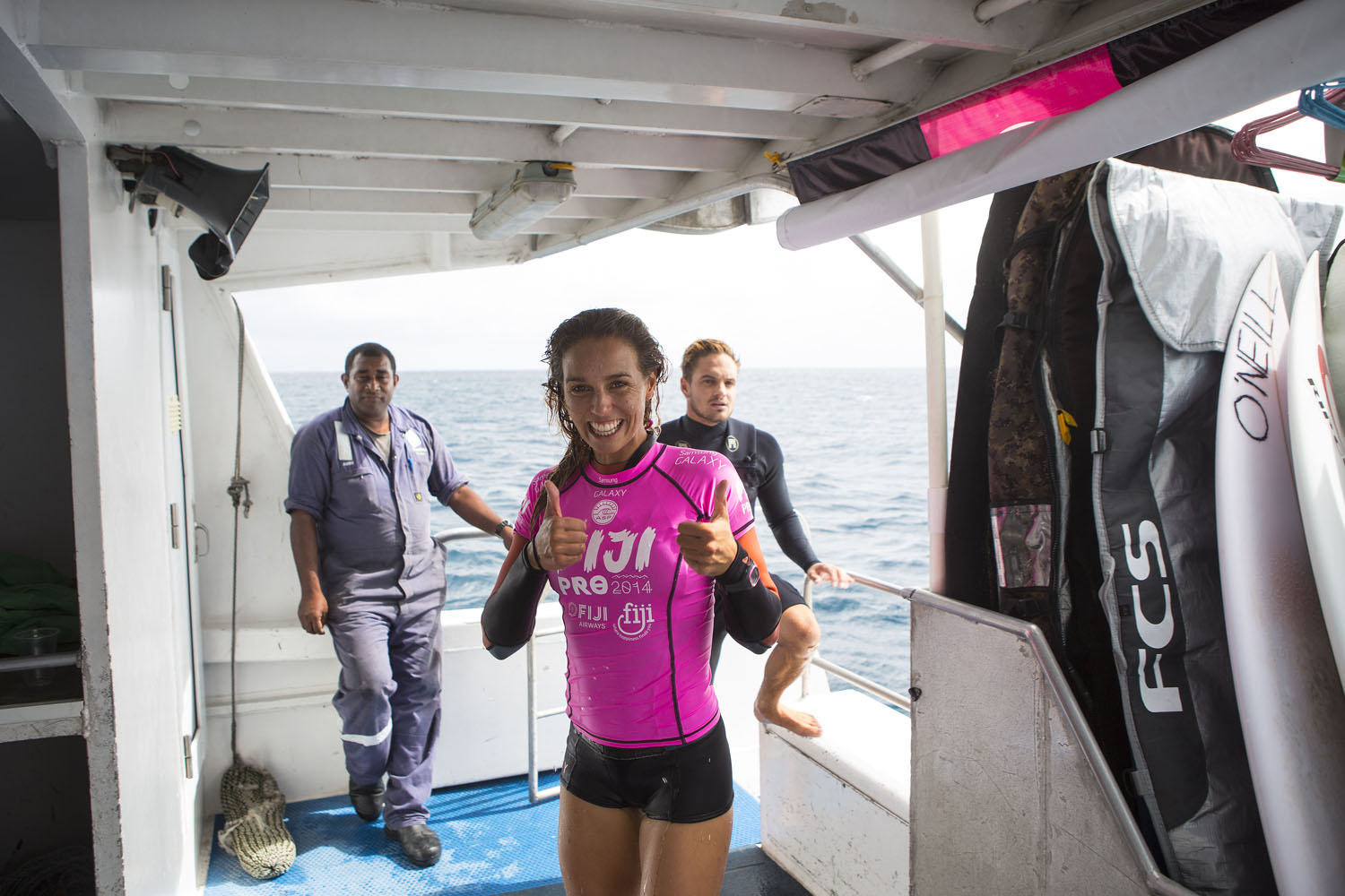After a solid victory in Round 1 of the Women's Fiji Pro, Fitzgibbons gives a thumbs up to photographer Kirstin Scholtz on May 27, 2014 in Tavarua, Fiji.