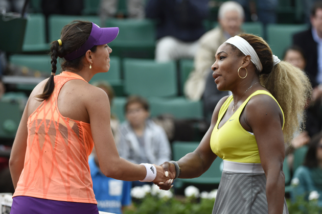 Muguruza shakes hands with Serena Williams at the end of their French tennis Open second round match at the Roland Garros stadium in May 2014.