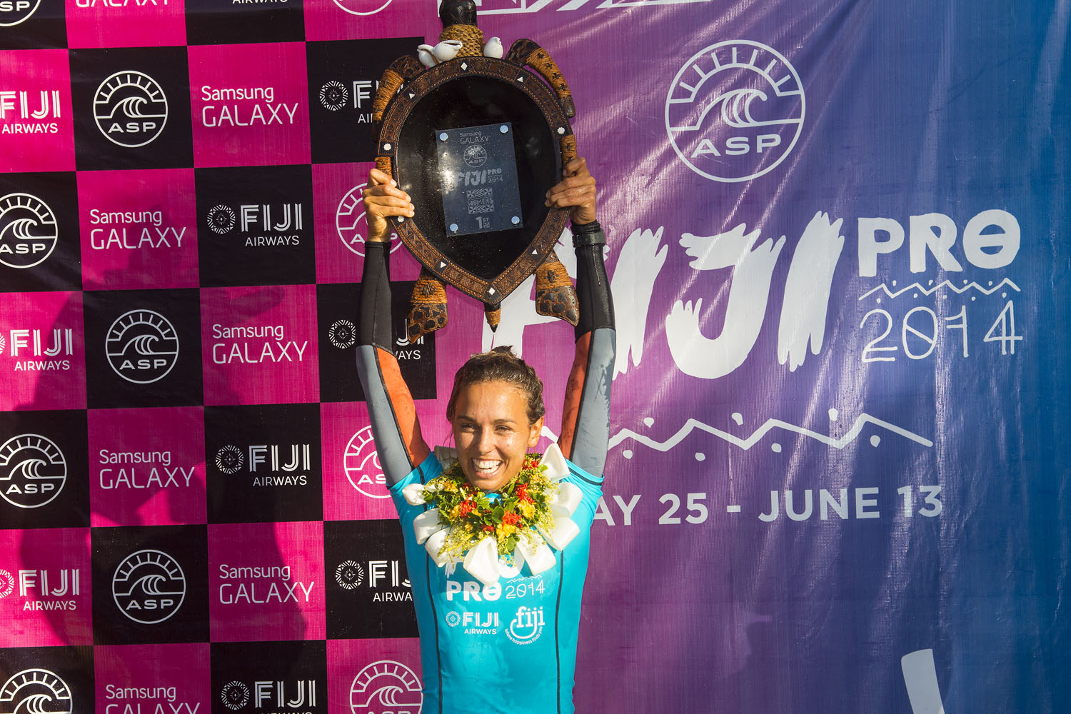 Sally Fitzgibbons stand victorious as the winner of the 2014 Women's Fiji Pro on May 29, 2014 in Tavarua, Fiji.
