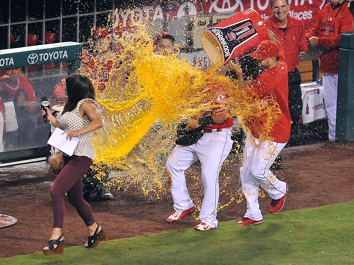 Kole Calhoun of the Angeles is drenched by pitcher Hector Santiago on a night in which Calhoun went 3 for 3 with two home runs to help the Angels defeat the Boston Red Sox 3-0.