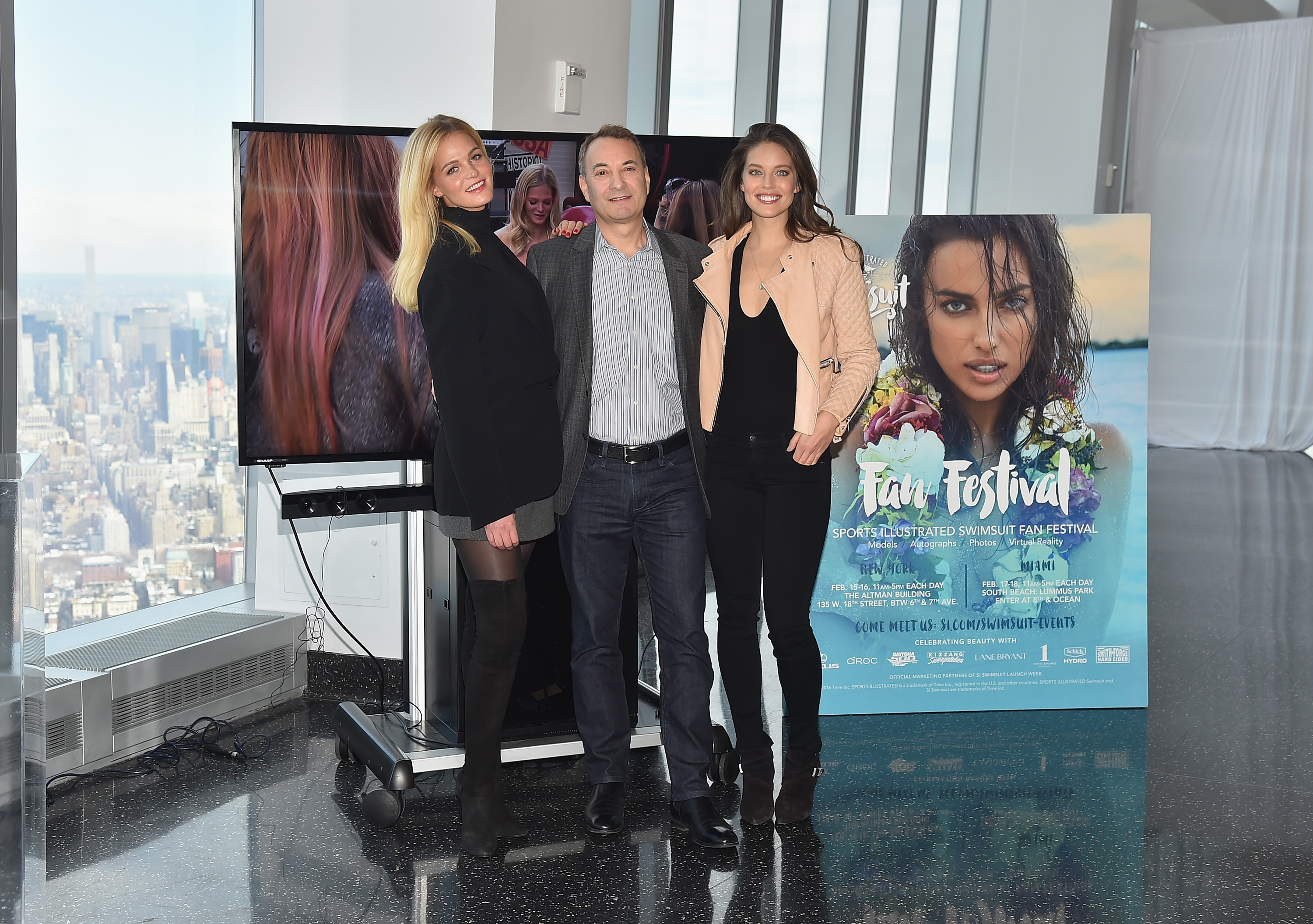 Sports Illustrated Swimsuit Models Emily DiDonato and Erin Heatherton, with SI's Editor-in-Chief Paul Fichtenbaum, reveal SI Swimsuit 2016 launch week events in New York City at One World Observatory