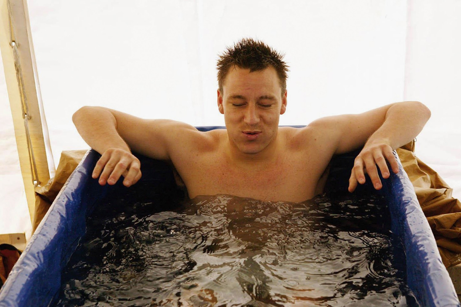 English defender John Terry sits in an ice bath to assist in recovery while at the squad's Lisbon training camp facility.