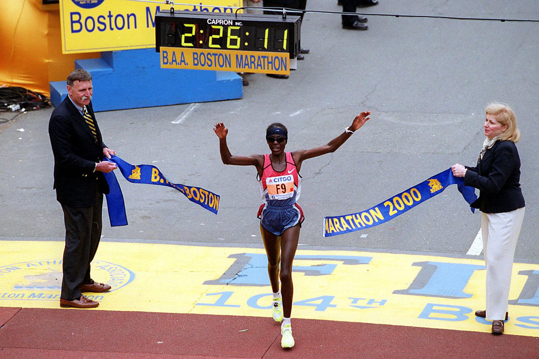 Catherine Ndereba crosses the finish line at the 104th Boston Marathon.