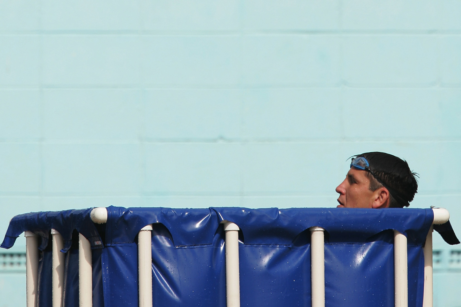 Former Australian rugby league footballer Steve Price takes an ice bath during a recovery session after the second week of the NRL finals between the Bulldogs and the Melbourne Storm at the Canterbury Pool.
