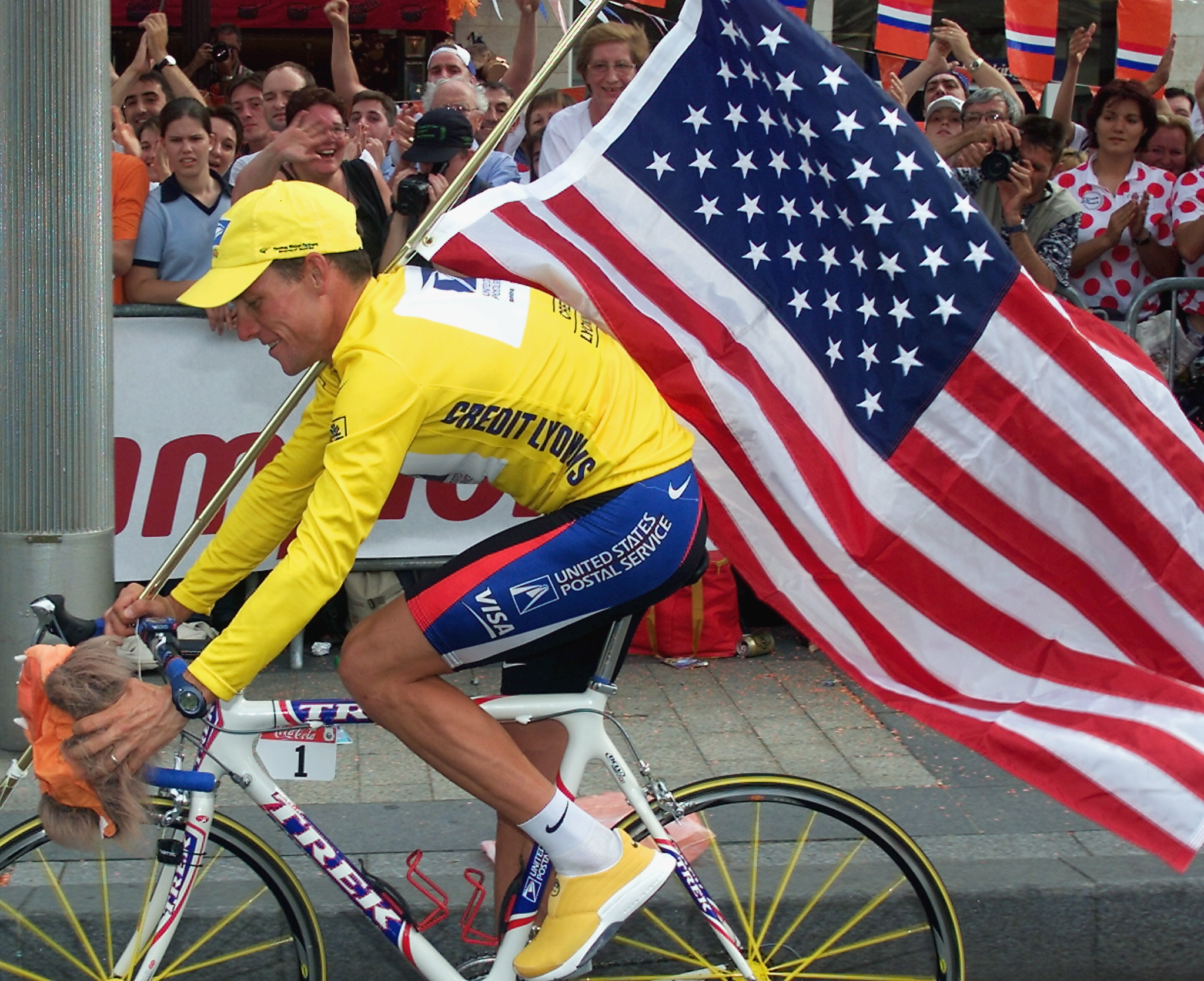 The 2000 Tour de France winner Lance Armstrong is supported by spectators  during his victory lap 518a69d17