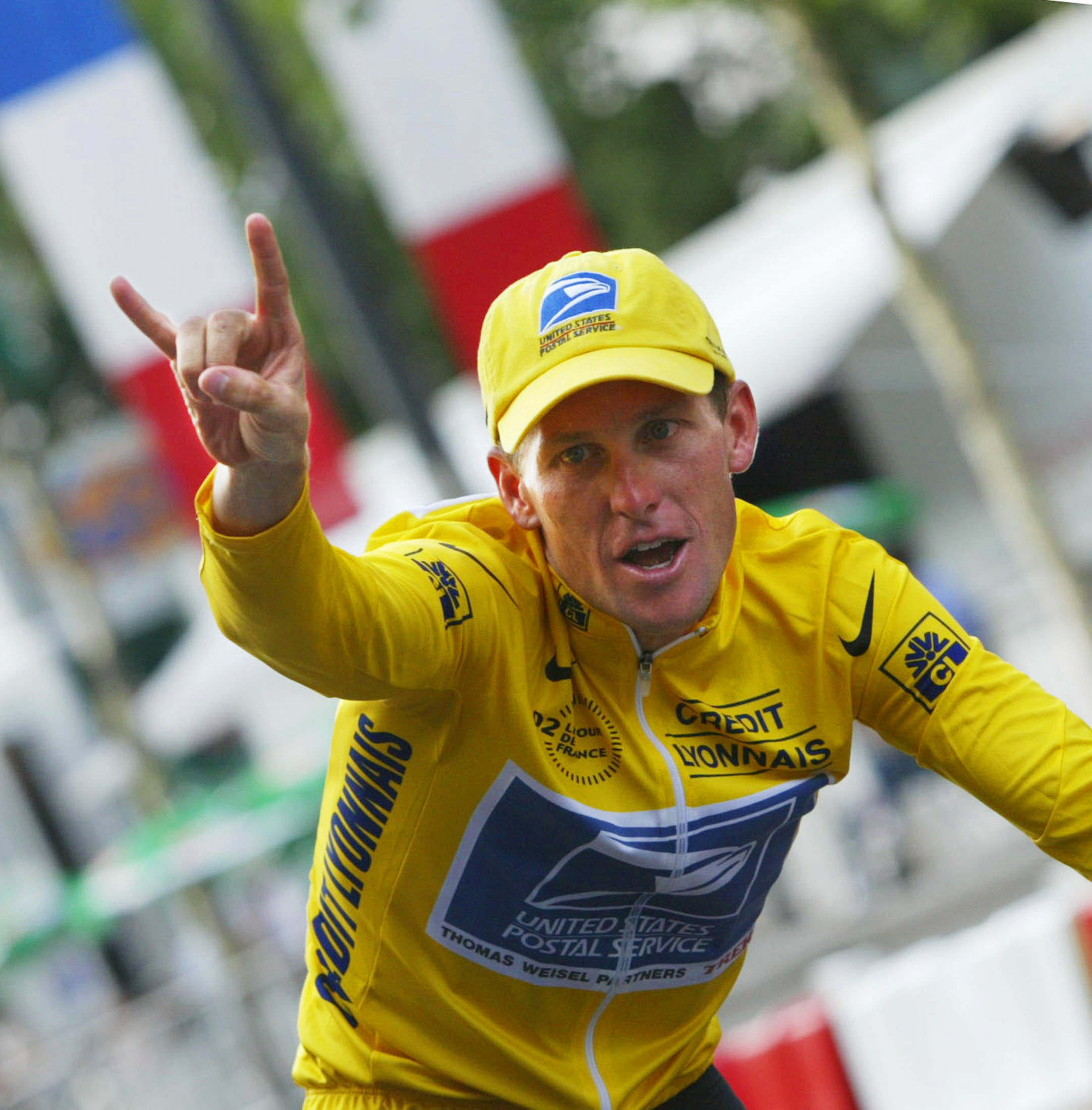 The 2002 Tour de France winner US Lance Armstrong celebrates as he makes his victory lap on the Champs-Elysees after the last stage of the 89th French cycling race in July 2002.